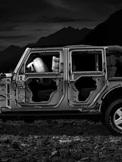 Skeleton of a Jeep in the Mountains